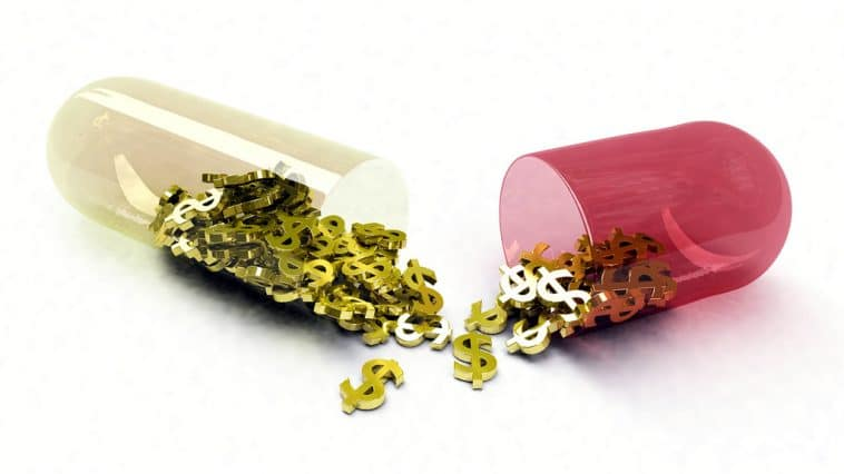 A capsule pill broken in half, with tiny gold dollar signs spilling out of each half