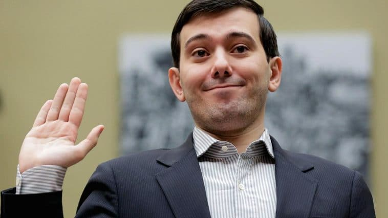 Martin Shkreli, who became the poster boy for high drug prices when his drug company raised the price of a lifesaving drug by 4,000%. He is holding up his right hand as he is sworn in to testify before Congress about an unrelated criminal indictment