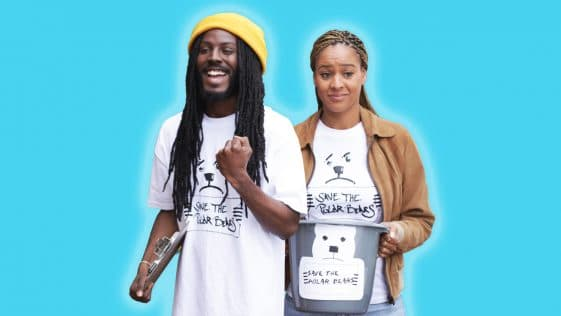 """Reyna Amaya and Donte Clark stand in front of a blue background. They are wearing shirts that say """"Save the Polar Bears,"""" and Nina is holding a donation bucket. Donte is making a triumphant gesture and smiling, while Nina looks more bemused"""