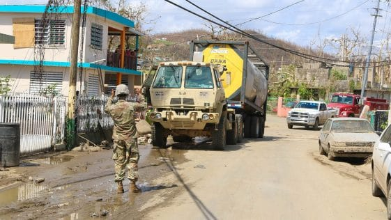 Puerto Rico National Guard soldiers, of the 783rd Maintenance Company, in Toa Baja, P.R. supporting the city after Hurricane María, transporting more than 6,000 gallons of water to the San José community, Sept. 24.